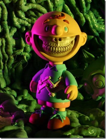 Read more about the article Grin Vinyl Figure By Ron English