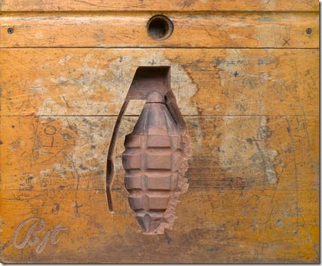 Read more about the article Weapons Carved into Wooden Desks