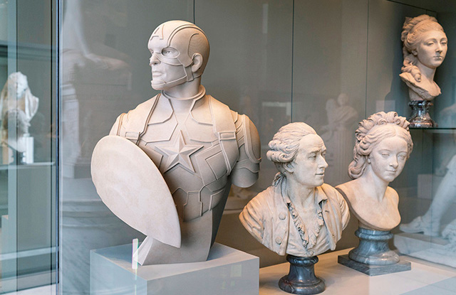 Read more about the article Superheroes as Classical Sculptures in The Louvre Museum
